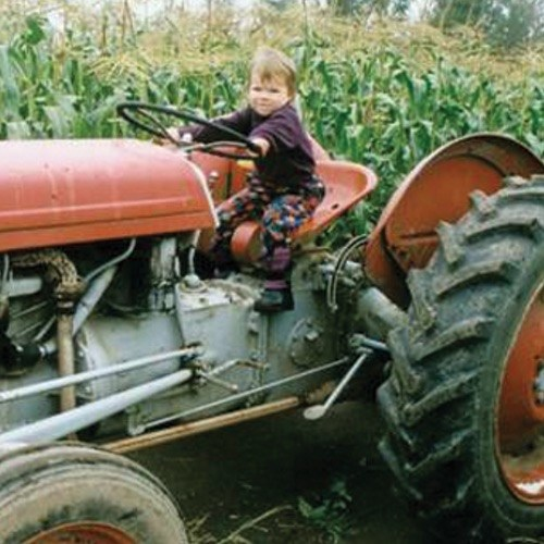 baby on tractor - Ralphs Farm Market , Langley BC